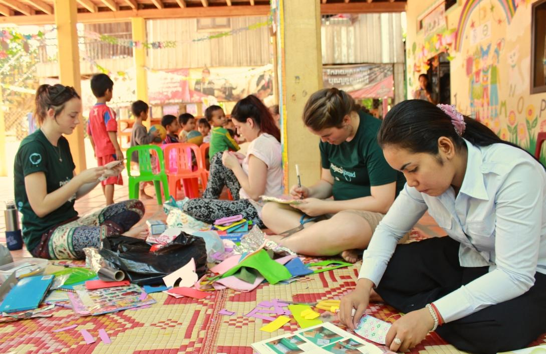 A group of High School Special volunteers is preparing an arts and crafts class for the local children during their care & community project in Cambodia.
